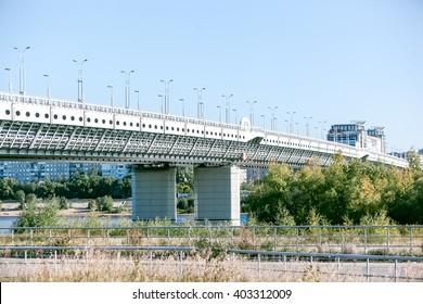 modern concrete bridge over the river industrial landscape