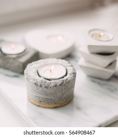 Modern concrete candlestick on marble background