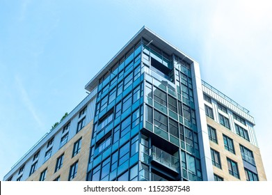 Modern condo buildings with huge windows in Montreal downtown, Canada.