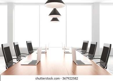 Modern conference room with furniture, laptops and big windows 3D Render