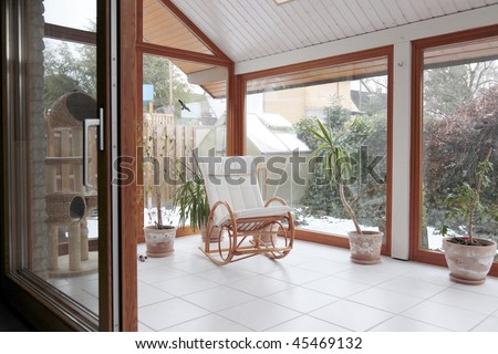 modern conservatory with a rocking chair