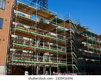 Modern construction site with scaffold platform sytem with clear blue sky background