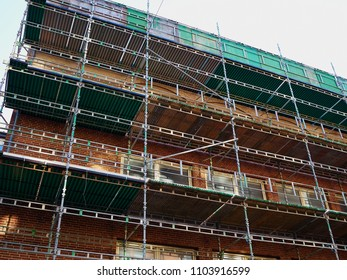 Modern construction site with scaffold platform sytem with clear gray sky background