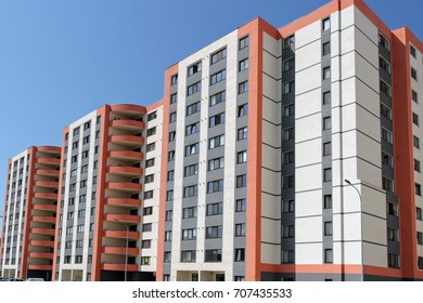 Modern construction work of new residential buildings under a blue sky