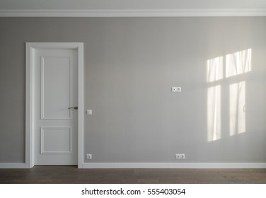 Modern contemporary interior. Wall and white door.