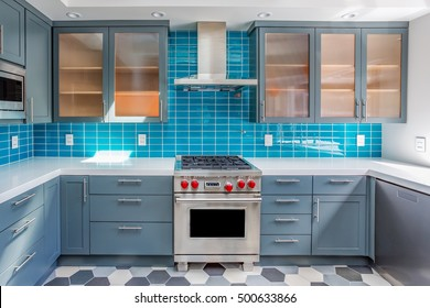 Modern Contemporary Kitchen with Blue, Orange and White Features