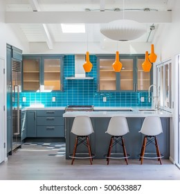 Modern Contemporary Kitchen with Blue, White, & Orange  Features