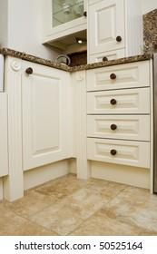 Modern contemporary kitchen interior with granite worktop and cream units