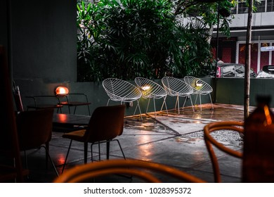 Modern and contemporary white wire net chairs. Outdoor minimalistic coffee shop design ideas.