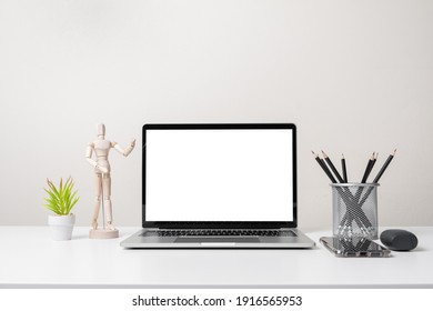 modern contemporary workspace with laptop computer, office stationery and supply on desk - front view
