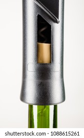 Modern corck screw on top of a red wine bottle