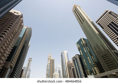 Modern corporate city. Skyscrapers wide angle view from the bottom. Business and finance theme. Dubai city main highway. Financial center.
