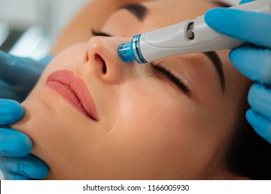 Modern cosmetology. Close up of a modern device for hydrafacial procedure used for face cleansing
