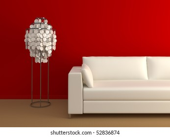 Modern couch and lamp near the red wall.