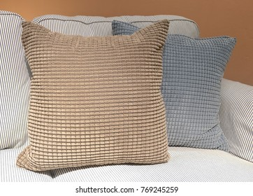 Modern Cozy Sofa with Brown and Gray Decorative Square Pillow or Cushion, Close Up.