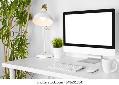 Modern creative designer workplace with desk computer on white table