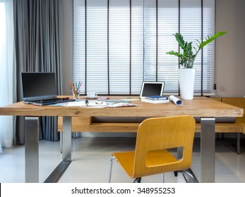 Modern creative workplace with laptop, tablet, equipment / Architect office design concept