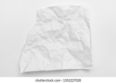 Modern crumpled white paper on empty sheet gray background with light shadows for creative wallpaper, card, art work design.