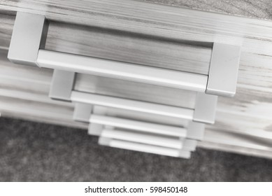 Modern cupboard with drawers, selective focus, metal handles
