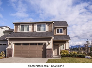 A modern custom built luxury home in a residential neighborhood.