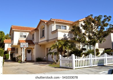 Modern custom made houses with nicely landscaped front the yard in the rich suburb of Manhattan Beach City, CA.
