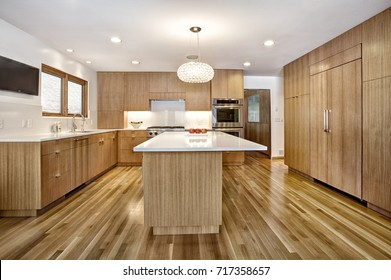 Modern custom quarter sawn white oak cabinets in a modern home.  The cabinets are designed for function and style.