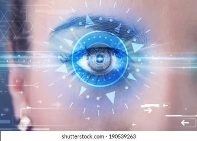 Modern cyber girl with technolgy eye looking into blue iris