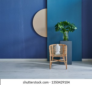 Modern dark blue stone wall, textured wall, blue decorative wall, chair vase of plant and table interior concept. Home wall background. parquet and modern background.