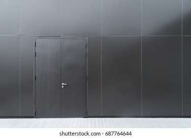 Modern dark wall with door
