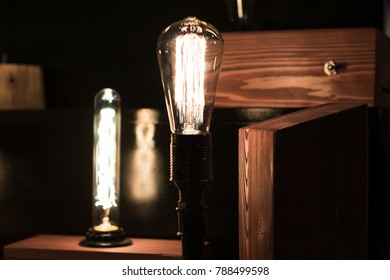 Modern decoration of electric Edison lamps. Incandescent lamps in a modern loft-style. Background of light bulbs.