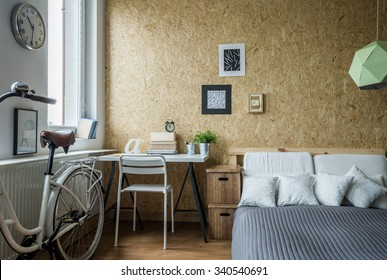 Modern decorations in room and wooden wall