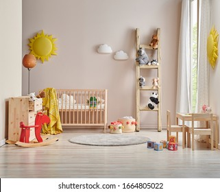 Modern decorative baby room, wooden crib and bed, pink chair, blanket, lamp and child toy with children table style.