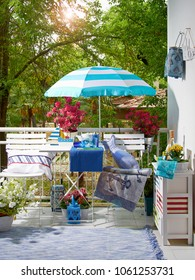 modern decorative balcony style. apartment exterior style with furniture and colorful object.