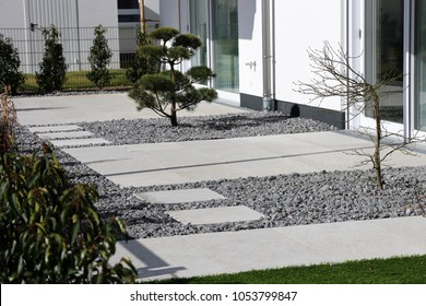 Modern decorative garden with grey terrace tiles