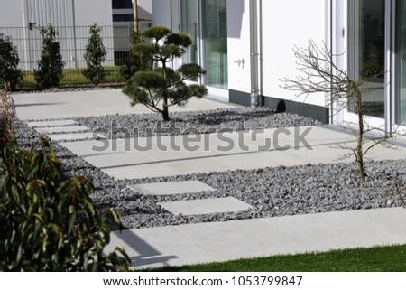 Modern Decorative Garden With Grey Terrace Tiles