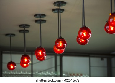 Modern decorative lamp supported by ceiling in house