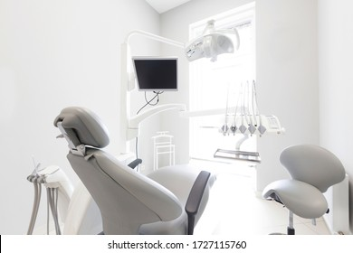 Modern dental practice. Professional chair and other accessories for doctor in room, medical light