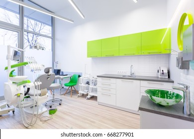 Modern dental room with green and white furniture