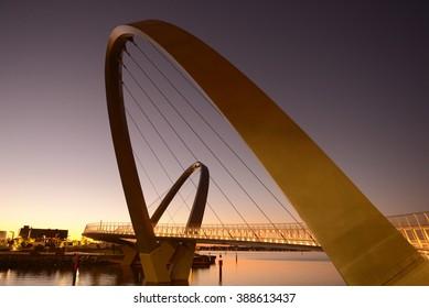 Modern design Arched bridges at entrance of Elizabeth Quay marina, new tourist attraction in Perth, Western Australia.