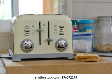 Modern design of the bread toaster in the kitchen interior