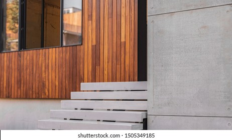 Modern design in cement and wood house exterior, side view