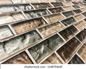 modern design of glass tiles used as a kitchen counter top backsplash or bathroom wall shower tiles