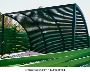 Modern design green metal pergola curved beam pattern in a house garden