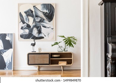Modern design home interior of living room with wooden commode, black piano, tropical leafs, sculpture and elegant accessories. Stylish home decor. Mock up abstract paintings on the wall. Template.
