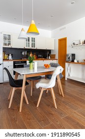 Modern design interior of dining room, kitchen, white furniture