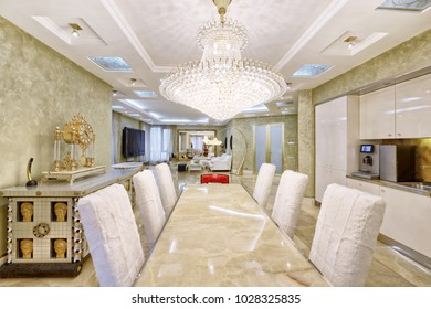 Modern design interior with white glossy kitchen in a luxurious apartment.
