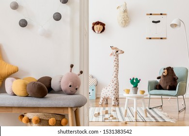 Modern and design scandinavian interior of kidroom with wooden bench, armachir, mock up poster frame, pillow, toys, teddy bear, plush toys and cute children's accessories. Stylish home decor. Template