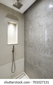 modern design shower corner with sedimented shell stone tiles