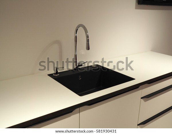 Modern design trendy kitchen with white and black wood elements