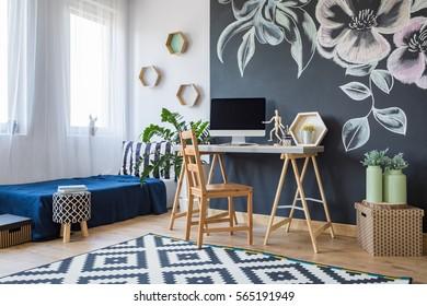 Modern designed bedroom with floral decoration on a black board